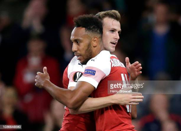 Pierre-Emerick Aubameyang of Arsenal celebrates after scoring his team's first goal with Rob Holding of Arsenal during the UEFA Europa League Group E...