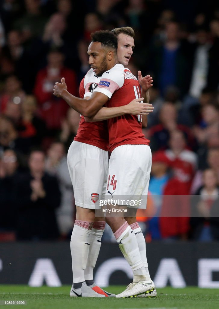 Pierre-Emerick Aubameyang of Arsenal celebrates after scoring his team's first goal with Rob Holding of Arsenal during the UEFA Europa League Group E match between Arsenal and Vorskla Poltava at Emirates Stadium on September 20, 2018 in London, United Kingdom.