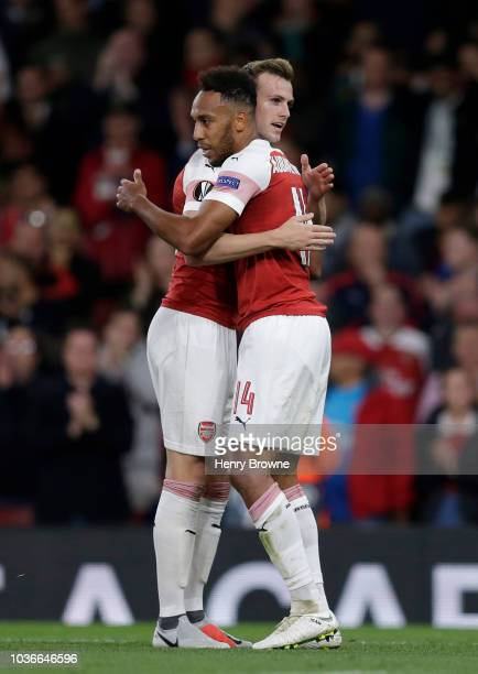 PierreEmerick Aubameyang of Arsenal celebrates after scoring his team's first goal with Rob Holding of Arsenal during the UEFA Europa League Group E...