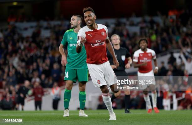 PierreEmerick Aubameyang of Arsenal celebrates after scoring his team's third goal during the UEFA Europa League Group E match between Arsenal and...