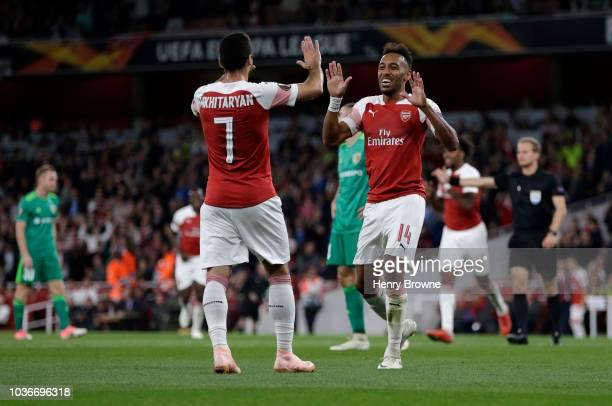 PierreEmerick Aubameyang of Arsenal celebrates after scoring his team's third goal with Henrikh Mkhitaryan of Arsenal during the UEFA Europa League...