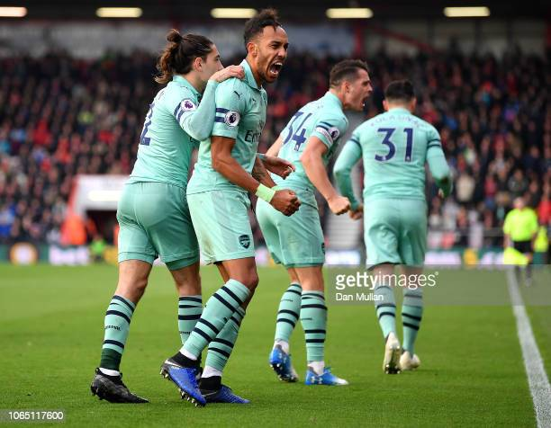 PierreEmerick Aubameyang of Arsenal celebrates after scoring his team's second goal with Hector Bellerin during the Premier League match between AFC...