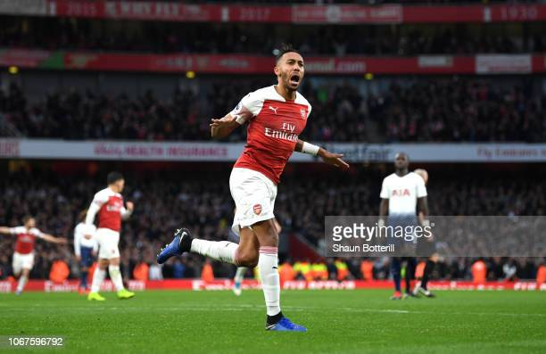 PierreEmerick Aubameyang of Arsenal celebrates after scoring his team's second goal during the Premier League match between Arsenal FC and Tottenham...