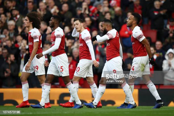 PierreEmerick Aubameyang of Arsenal celebrates after scoring his team's first goal with his team mates during the Premier League match between...