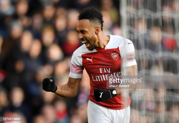 PierreEmerick Aubameyang of Arsenal celebrates after scoring his team's second goal during the Premier League match between Arsenal FC and Burnley FC...