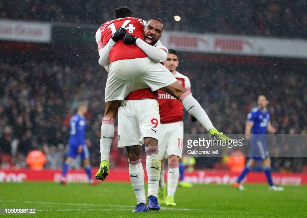 PierreEmerick Aubameyang of Arsenal celebrates after scoring his team's first goal with Alexandre Lacazette of Arsenal during the Premier League...