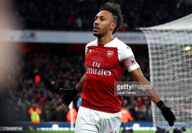 PierreEmerick Aubameyang of Arsenal celebrates after scoring his team's second goal during the Premier League match between Arsenal FC and Manchester...