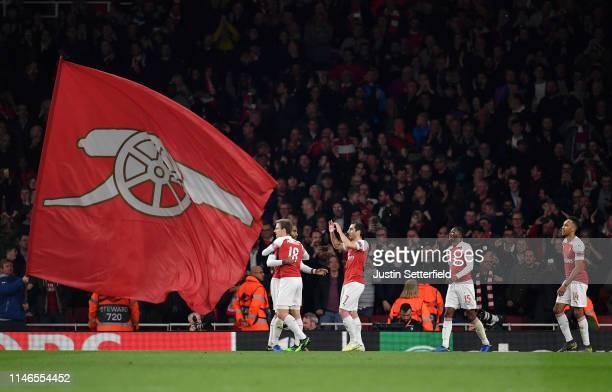 PierreEmerick Aubameyang of Arsenal celebrates after scoring his team's third goal with team mates during the UEFA Europa League Semi Final First Leg...