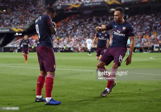PierreEmerick Aubameyang of Arsenal celebrates after scoring his team's first goal with Alexandre Lacazette during the UEFA Europa League Semi Final...