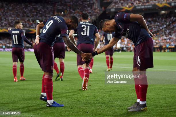 Pierre-Emerick Aubameyang of Arsenal celebrates after scoring his team's first goal with teammate Alexandre Lacazette during the UEFA Europa League...