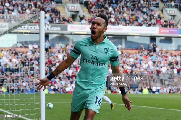 PierreEmerick Aubameyang of Arsenal celebrates after scoring his team's first goal during the Premier League match between Burnley FC and Arsenal FC...