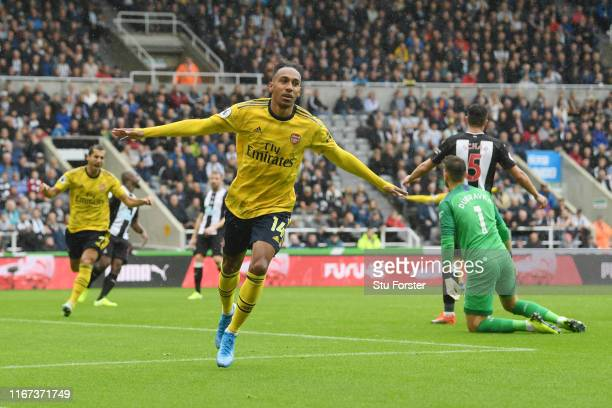 Pierre-Emerick Aubameyang of Arsenal celebrates after scoring his team's first goal during the Premier League match between Newcastle United and...