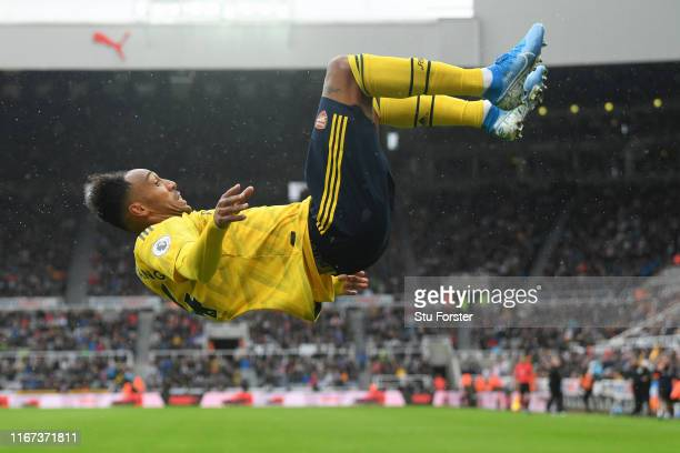 PierreEmerick Aubameyang of Arsenal celebrates after scoring his team's first goal during the Premier League match between Newcastle United and...