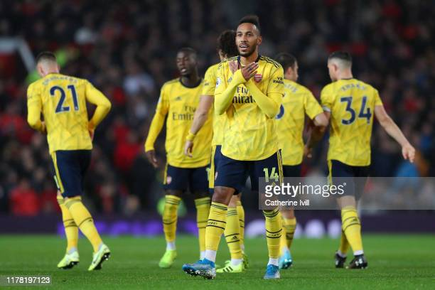PierreEmerick Aubameyang of Arsenal celebrates after scoring his team's first goal during the Premier League match between Manchester United and...