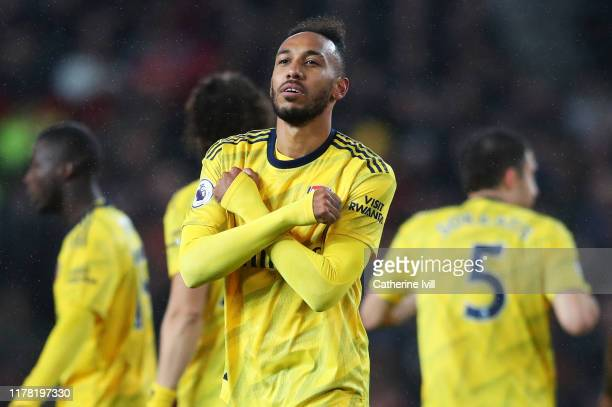 Pierre-Emerick Aubameyang of Arsenal celebrates after scoring his team's first goal during the Premier League match between Manchester United and...