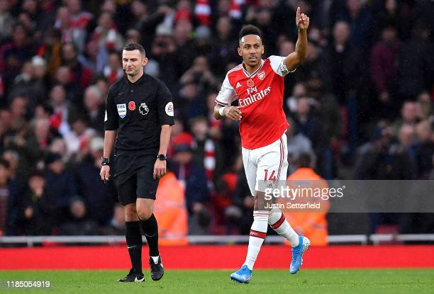 PierreEmerick Aubameyang of Arsenal celebrates after scoring his team's first goal during the Premier League match between Arsenal FC and...