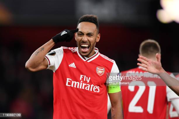 PierreEmerick Aubameyang of Arsenal celebrates after scoring his team's first goal during the UEFA Europa League group F match between Arsenal FC and...