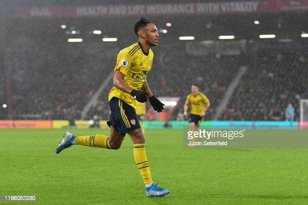 PierreEmerick Aubameyang of Arsenal celebrates after scoring his team's first goal during the Premier League match between AFC Bournemouth and...