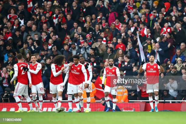 PierreEmerick Aubameyang of Arsenal celebrates after scoring his sides first goal during the Premier League match between Arsenal FC and Chelsea FC...