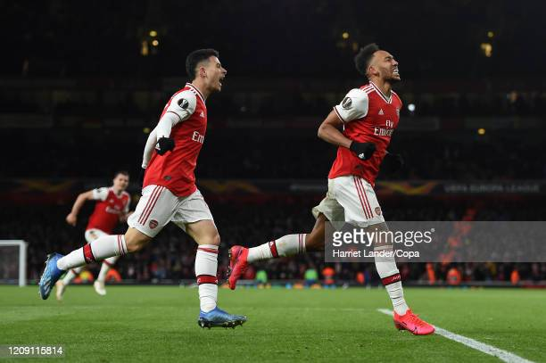 PierreEmerick Aubameyang of Arsenal celebrates after scoring his team's first goal during the UEFA Europa League round of 32 second leg match between...