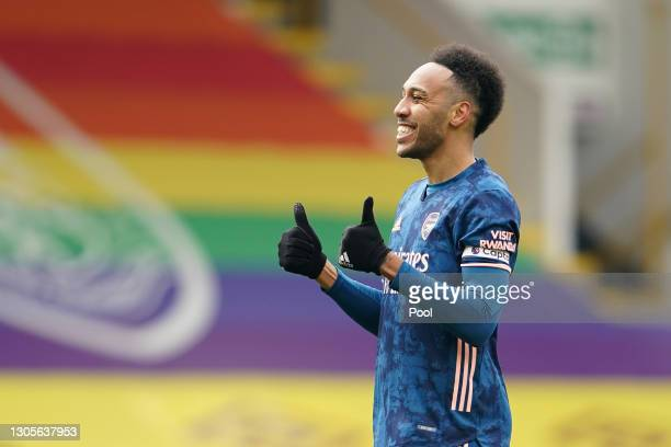 Pierre-Emerick Aubameyang of Arsenal celebrates after scoring his team's first goal during the Premier League match between Burnley and Arsenal at...