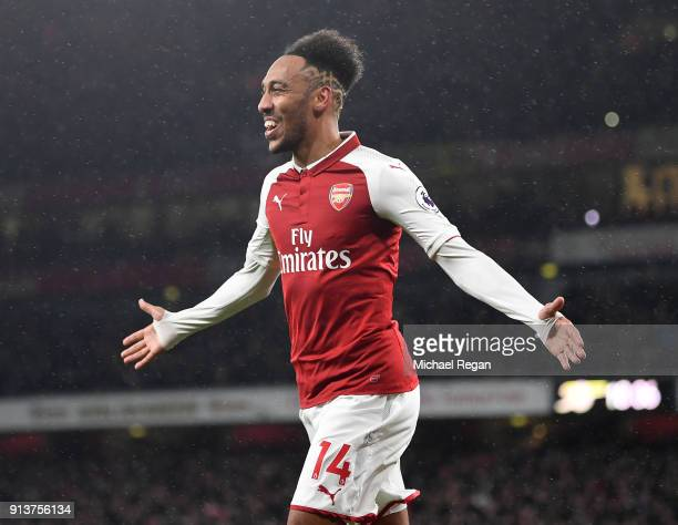 PierreEmerick Aubameyang of Arsenal celebrates after scoring his sides fourth goal during the Premier League match between Arsenal and Everton at...