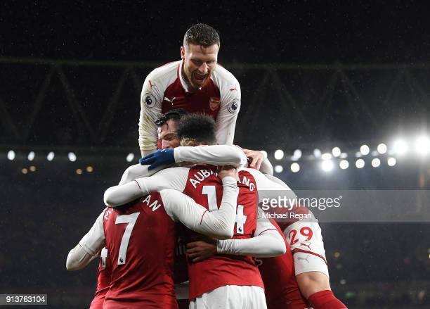 PierreEmerick Aubameyang of Arsenal celebrates after scoring his sides fourth goal with teammates during the Premier League match between Arsenal and...