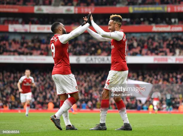 PierreEmerick Aubameyang of Arsenal celebrates after scoring his sides second goal with Alexandre Lacazette of Arsenal during the Premier League...