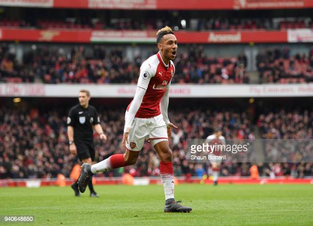 PierreEmerick Aubameyang of Arsenal celebrates after scoring his sides second goal during the Premier League match between Arsenal and Stoke City at...