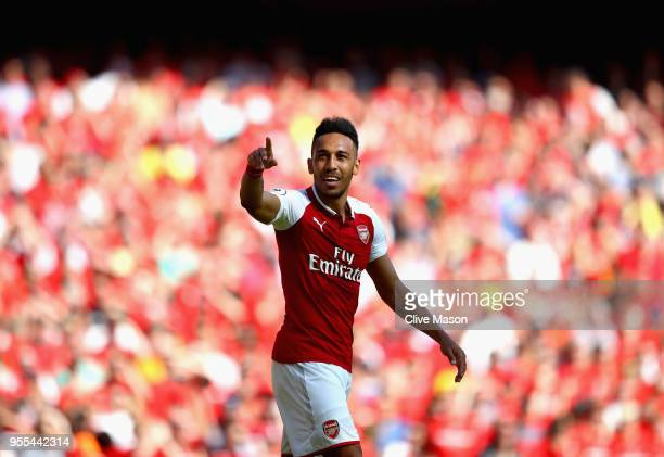 PierreEmerick Aubameyang of Arsenal celebrates after scoring his sides first goal during the Premier League match between Arsenal and Burnley at...