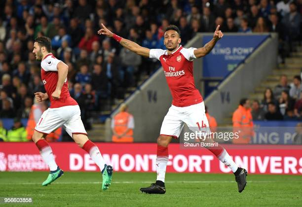 PierreEmerick Aubameyang of Arsenal celebrates after scoring his sides first goal during the Premier League match between Leicester City and Arsenal...