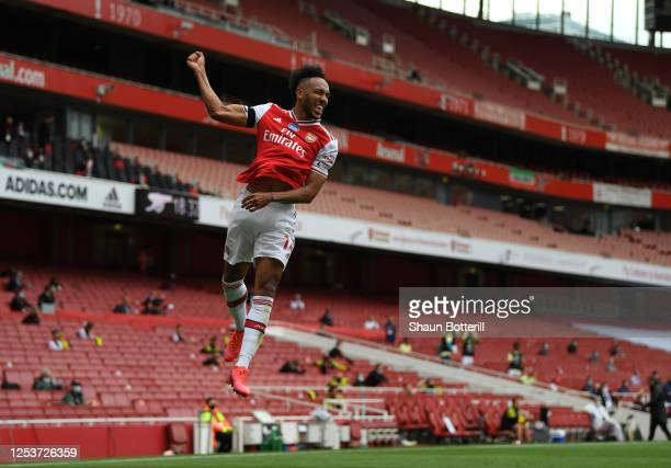 PierreEmerick Aubameyang of Arsenal celebrates after scoring the first goal during the Premier League match between Arsenal FC and Norwich City at...