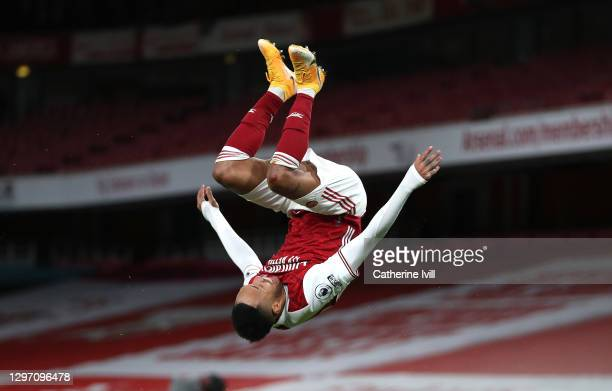 Pierre-Emerick Aubameyang of Arsenal celebrates after scoring their team's first goal during the Premier League match between Arsenal and Newcastle...