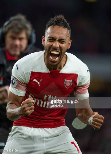 PierreEmerick Aubameyang of Arsenal celebrates after the Premier League match between Arsenal FC and Tottenham Hotspur FC at the Emirates Stadium on...