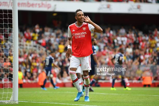 Pierre-Emerick Aubameyang of Arsenal celebrates his goal to make it 1-0 during the Emirates Cup match between Arsenal and Olympique Lyonnais at the...
