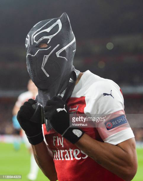 PierreEmerick Aubameyang of Arsenal celebrates his second goal by wearing a mask of the Marvel Comics character the Black Panther during the UEFA...