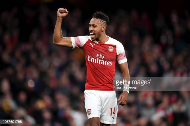 Pierre-Emerick Aubameyang of Arsenal celebrates his team's victory after the Premier League match between Arsenal FC and Tottenham Hotspur at...