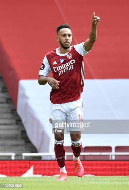 PierreEmerick Aubameyang of Arsenal celebrates scoring a penalty during the Premier League match between Arsenal FC and Watford FC at Emirates...