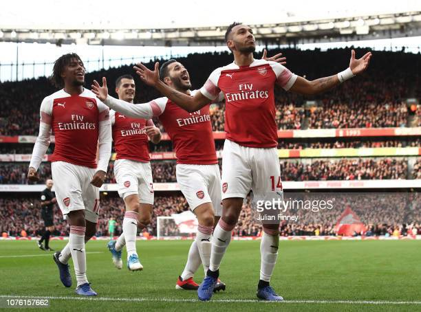 PierreEmerick Aubameyang of Arsenal celebrates scoring from the penalty spot during the Premier League match between Arsenal FC and Tottenham Hotspur...