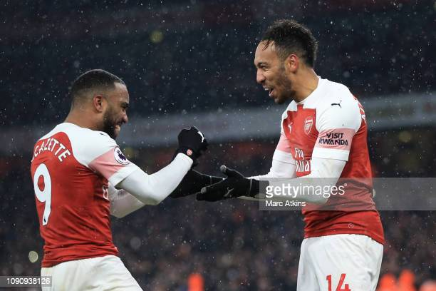 PierreEmerick Aubameyang of Arsenal celebrates scoring from the penalty spot wit Alexandre Lacazette during the Premier League match between Arsenal...