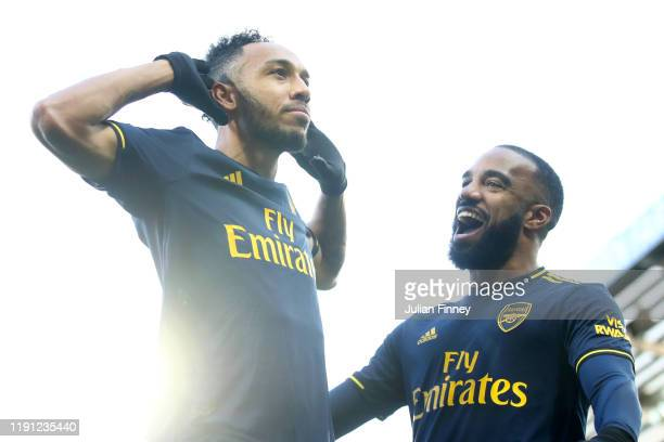 Pierre-Emerick Aubameyang of Arsenal celebrates scoring his sides first goal in front of Alexandre Lacazette during the Premier League match between...