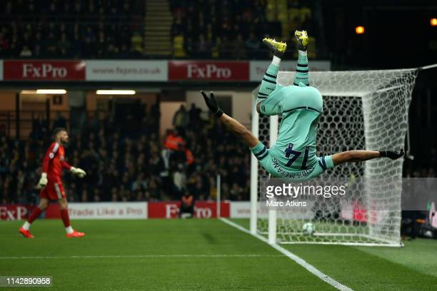 PierreEmerick Aubameyang of Arsenal celebrates scoring his side's first goal during the Premier League match between Watford FC and Arsenal FC at...