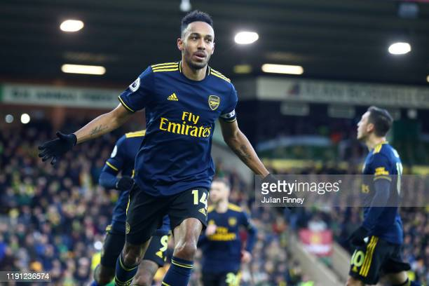 Pierre-Emerick Aubameyang of Arsenal celebrates scoring his sides first goal during the Premier League match between Norwich City and Arsenal FC at...