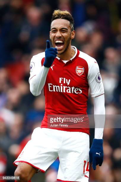 PierreEmerick Aubameyang of Arsenal celebrates scoring his sides first goal during the Premier League match between Arsenal and Southampton at...