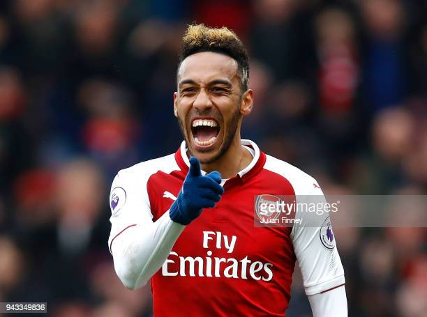PierreEmerick Aubameyang of Arsenal celebrates scoring his sides first goal during the Premier League match between Arsenal and Southampton at...