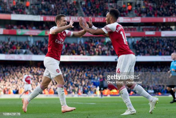 PierreEmerick Aubameyang of Arsenal celebrates scoring his teams second goal during the Premier League match between Arsenal and Everton at The...