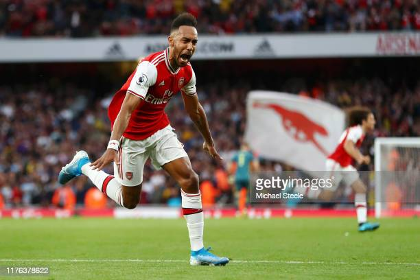PierreEmerick Aubameyang of Arsenal celebrates scoring his team's third goal during the Premier League match between Arsenal FC and Aston Villa at...
