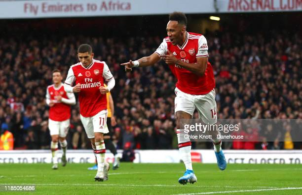 PierreEmerick Aubameyang of Arsenal celebrates scoring his teams first goal during the Premier League match between Arsenal FC and Wolverhampton...