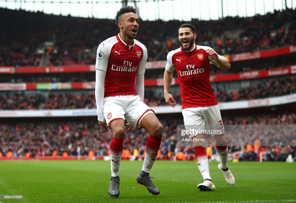 Pierre-Emerick Aubameyang of Arsenal celebrates scoring the 2nd Arsenal goal with Sead Kolasinac of Arsenal during the Premier League match between Arsenal and Watford at Emirates Stadium on March 11, 2018 in London, England.
