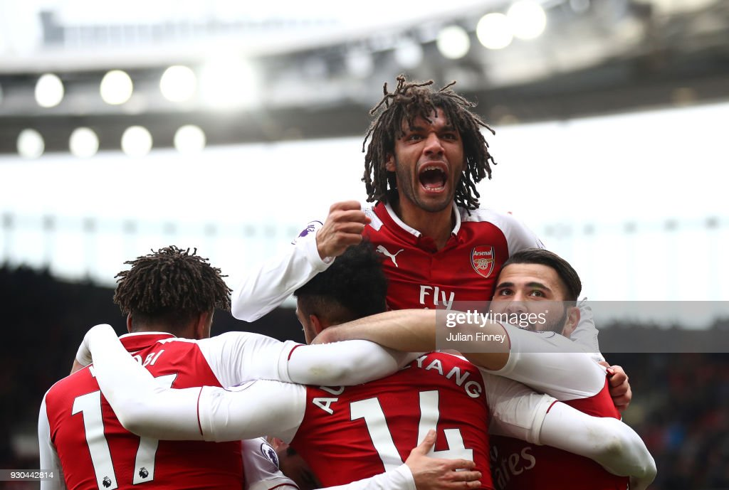 Pierre-Emerick Aubameyang of Arsenal celebrates scoring the 2nd Arsenal goal with Mohamed Elneny of Arsenal during the Premier League match between Arsenal and Watford at Emirates Stadium on March 11, 2018 in London, England.